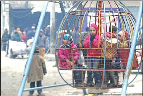 children play while waiting to be evacuated with others